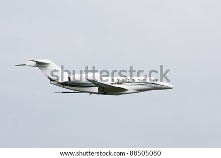 Private luxury jet airliner in flight.