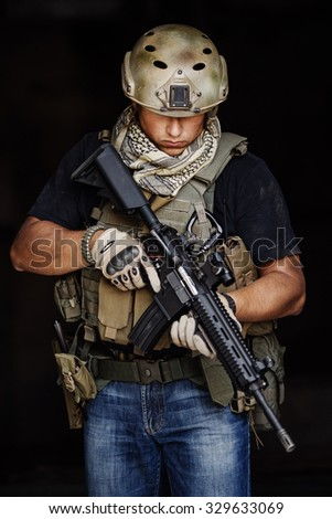 Private Military Contractor during the special secret operation on dark background