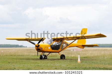 Private propeller-driven airplane on green grass