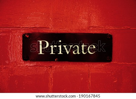 Private sign on red door