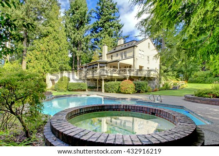 Private swimming pool at summertime - stock photo