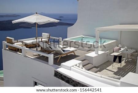 private terrace in a luxurious villa in santorini greece - stock photo