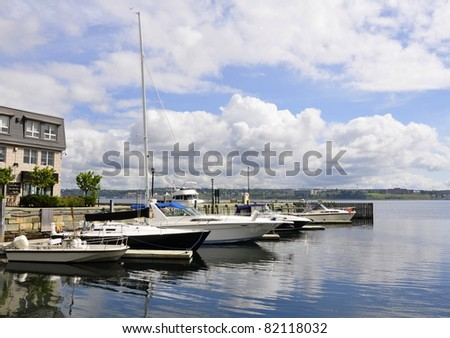 private yacht anchored at Halifax harbour, Nova Scotia Canada - stock photo