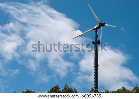 Privately owned Windmill supplying power for three homes in the bush in New Zealand