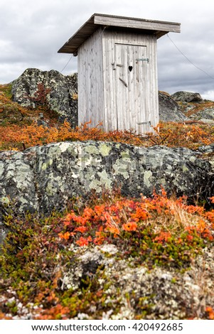 privy outhouse in the wilderness of northern Sweden - stock photo