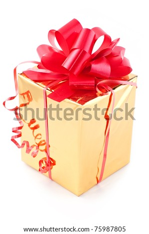 Prize a gift with a red tape in a gold wrapper close up. - stock photo