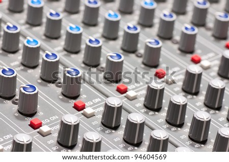 Pro audio mixing board at a recording studio - stock photo