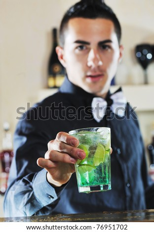 pro barman prepare cocktail drink and representing nightlife and party event  concept - stock photo