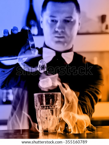 pro barman prepare coctail drink and representing nightlife and party event  concept - stock photo