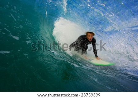 Pro Surfer In Blue Tube - stock photo