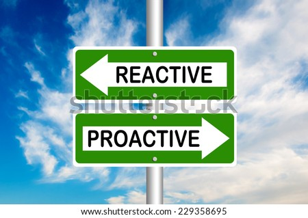 Proactive and reactive road signs with a blue sky in a background.  Choose your strategy  - stock photo
