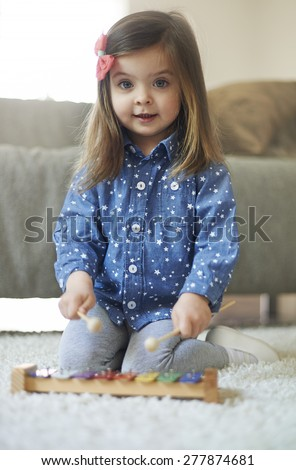 Probably she will be musician in the future  - stock photo