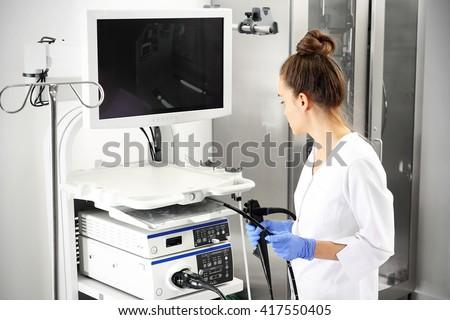 Probe colonoscope. Doctor gastroenterologist with probe to perform gastroscopy and colonoscopy   - stock photo