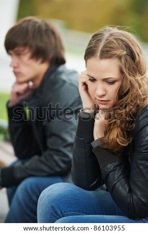 problem depression relationship difficulties of young couple people outdoors - stock photo