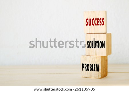 Problem, solution and success words on three wooden cubes, step to success in business concept - stock photo