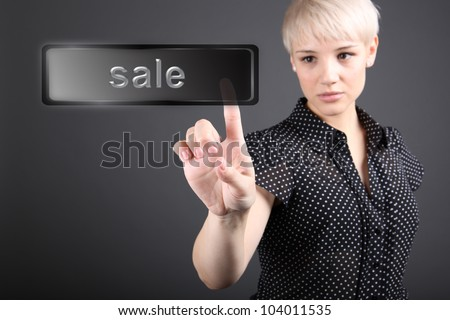 Problem solving concept - business woman touching screen with SALE sign - stock photo