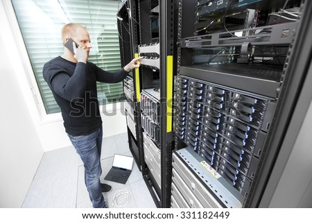 Problem solving IT consultant in datacenter - stock photo