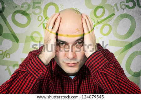 Problem with mortgage rates. Man having headache because of mortgage rates, computer generated percentage signs fly around his head.