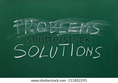 problems and solutions words on chalk board - stock photo
