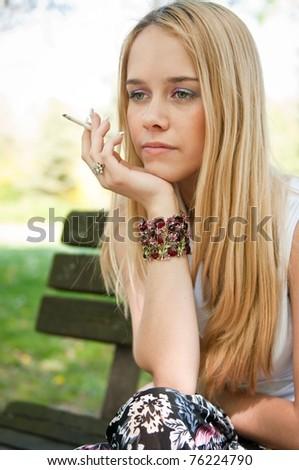 Problems - teenager smoking cigarette - stock photo