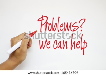 Problems? We Can Help sign on whiteboard - stock photo