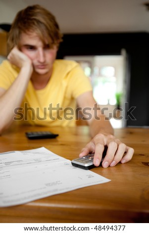 problems wit paying bill. Focus on hand and mobile - stock photo