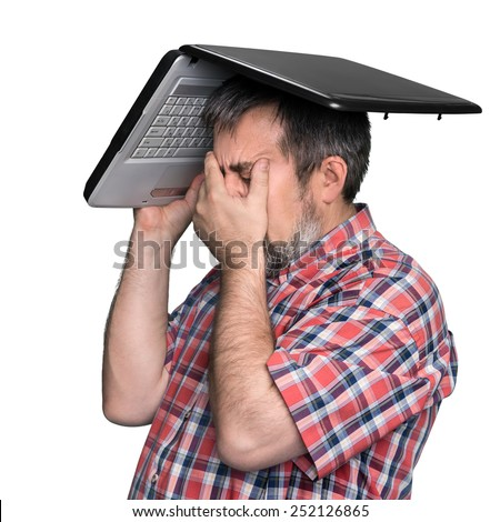 Problems with computer. Middle aged stressed businessman with laptop on the head isolated on white background - stock photo