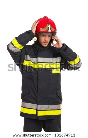 Problems. Worried fireman talking on the phone. Three quarter length studio shot isolated on white. - stock photo