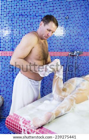 procedure wellness foam massage woman in hammam - stock photo