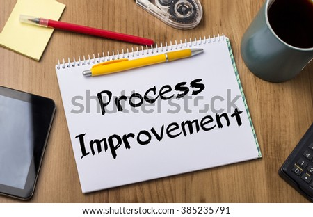 Process Improvement - Note Pad With Text On Wooden Table - with office  tools - stock photo