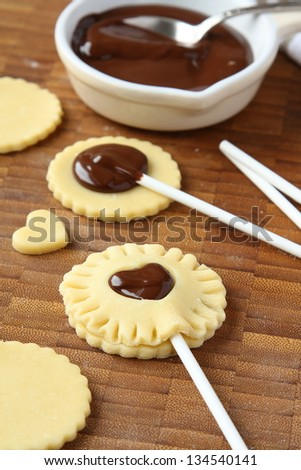 Process of baking homemade shortbread cookies pops with chocolate - stock photo
