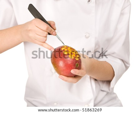 Process of carving a mango isolated on white background