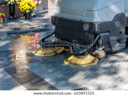 process of cleaning walkways in the machine - stock photo