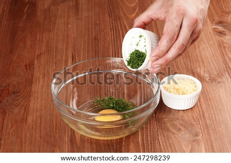 process of cooking omelet with cheese and greens. preparation food ingredients - stock photo