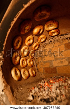 process of cooking tandoor bread in national tandoor owen