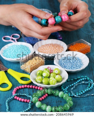 Process of creating costume jewelry close-up - stock photo