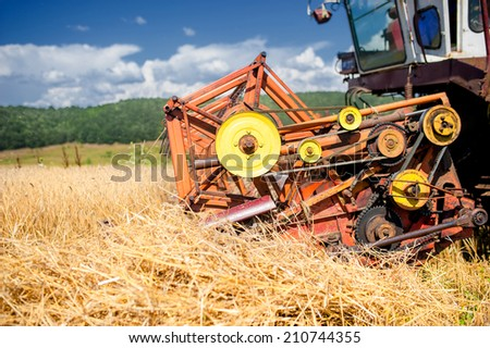 process of harvesting with combine, gathering mature grain crops from field. - stock photo