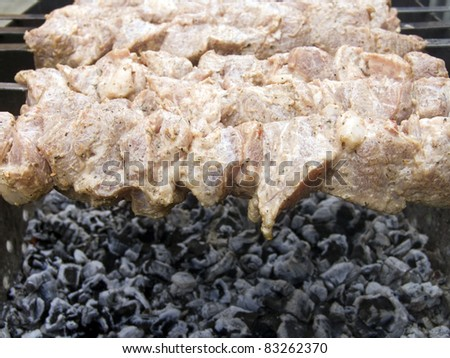 Process of preparation of a shish kebab, from uncooked to the cooked - stock photo