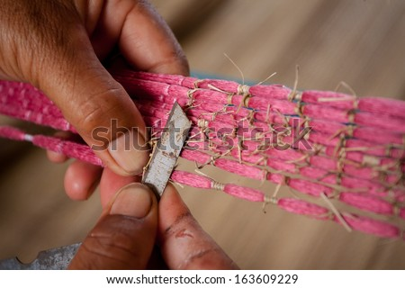 Process of weaving, dyeing, weaving ancient Thailand as silk - stock photo