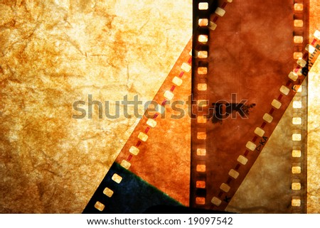 Processed film strips close-up over grunge background - stock photo