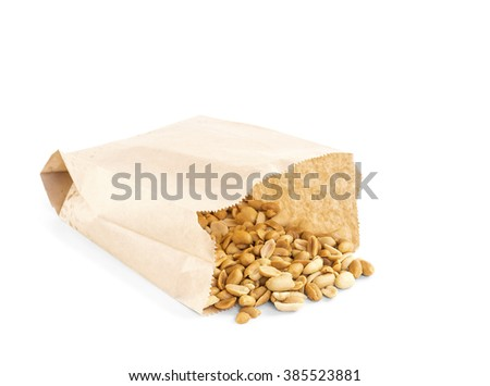 Processed peanuts in paper bag over white background with copy-space, shallow focus - stock photo