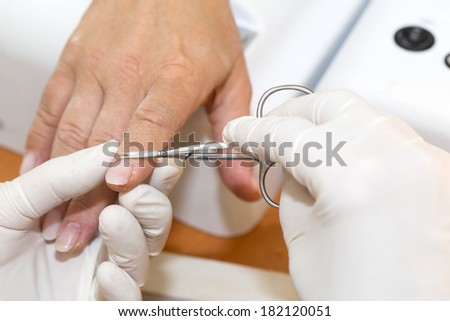 processes work on a manicure in the salon