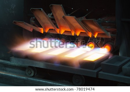 processing of gold bullion - stock photo