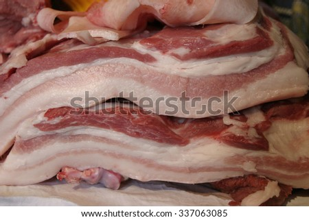 processing pork products typical bacon pig Modena Emilia Romagna - stock photo
