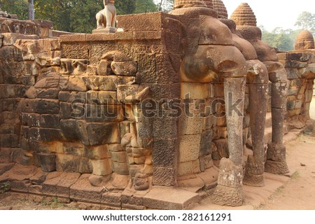 Procession of elephants on the Elephant Terrace, Angkor Thom,  Cambodia - stock photo