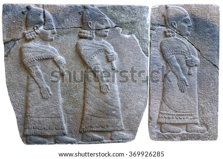 Procession of palace officials - ancient stone bas-relief of late Hittite period (8th Cent. B.C.) from Samal (Sinjerli) in the Istanbul Archaeology Museum in Istanbul, Turkey - stock photo