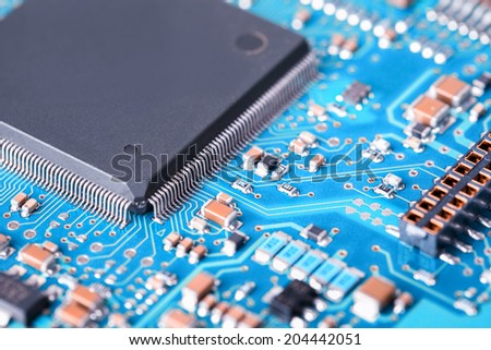 processor and blue circuit board closeup , abstract technology background  - stock photo