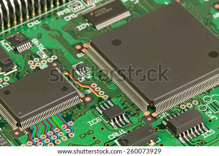 Processor and memory chips on a green circuit board. - stock photo