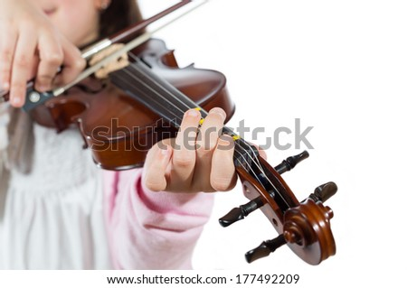 Prodigy playing the violin in the school of music - stock photo