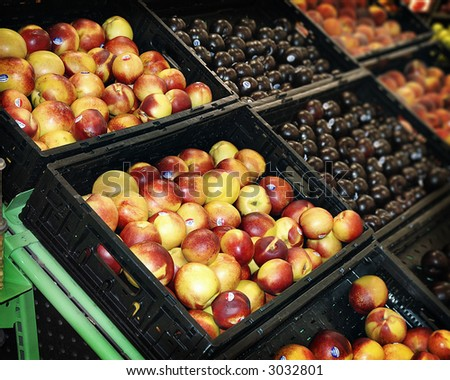 Produce bins in supermarket - stock photo